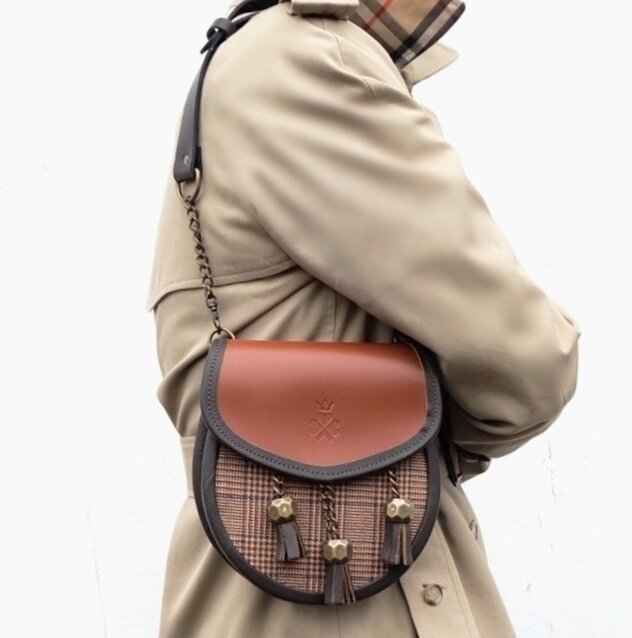 Nixey Glen Keith Tweed Sporran Handbag in Chestnut Leather with Bronze Fittings on model as shoulder bag