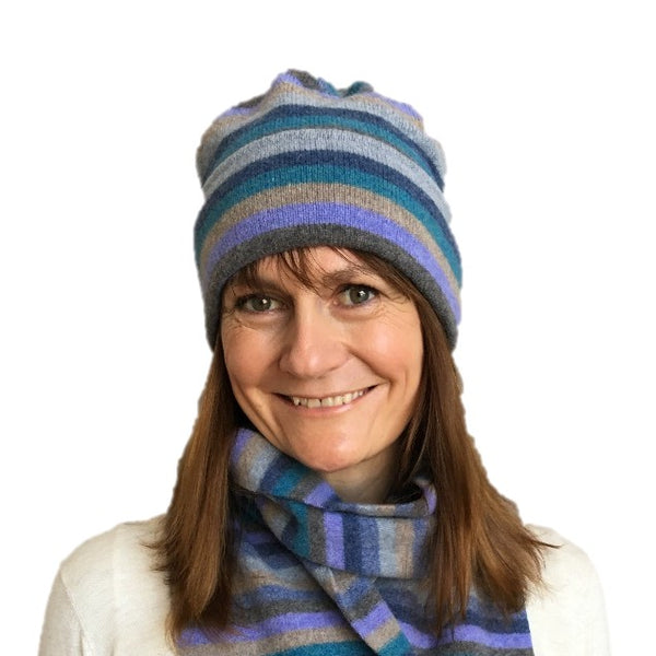 Old School Beauly Knitwear - Inverness Blue Skies Hat on model with matching scarf