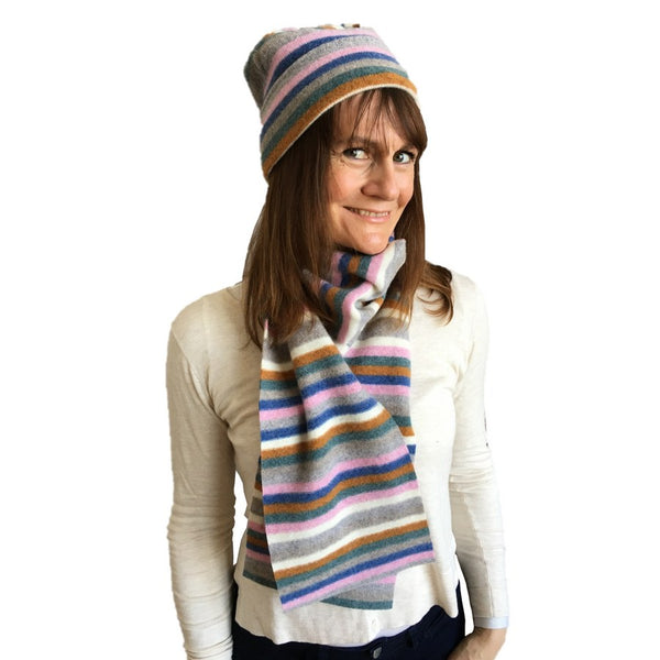Old School Beauly Knitwear - Inverness Pink Skies Hat on model with scarf