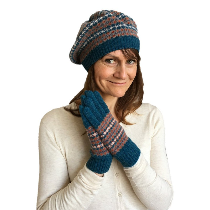 Old School Beauly Knitwear - Wee Nessie Hat on model with matching gloves