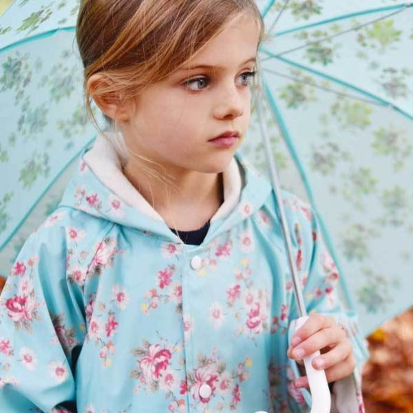 Powell Craft Blue Floral Raincoat on girl with umbrella