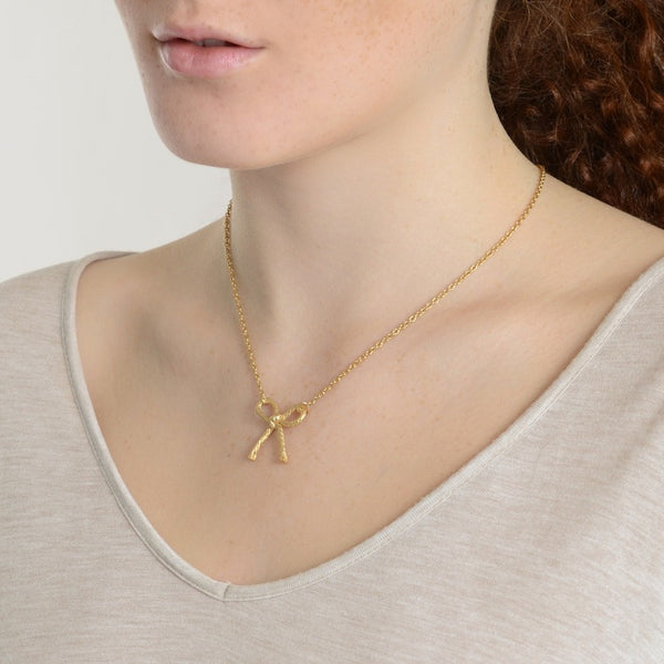 Knotted String Bow Yellow Gold Necklace on model