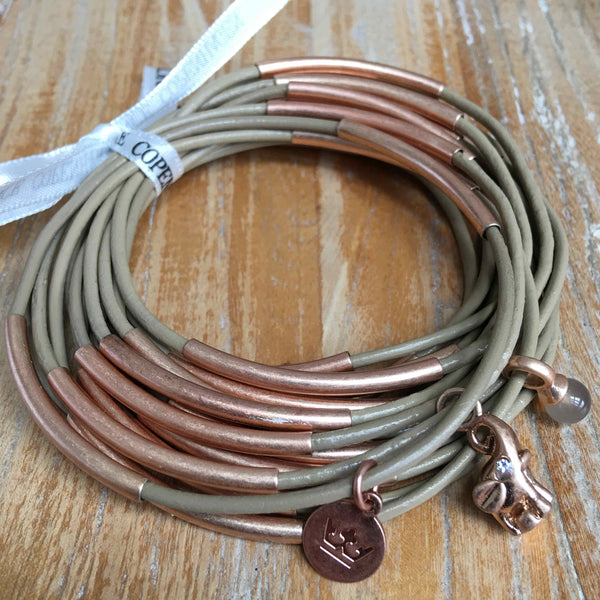 Sence Copengagen Urban Gypsy Bracelet Taupe Worn Rose Gold Z439 on wood