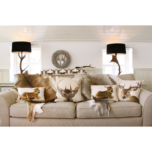 Deer stag cushions on sofa