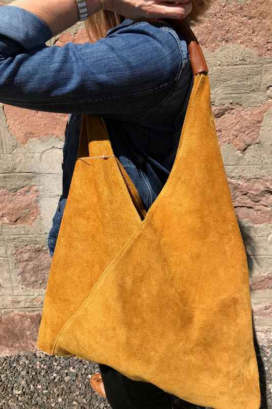 Suede Slouch Bag in Gorse Yellow on model close-up