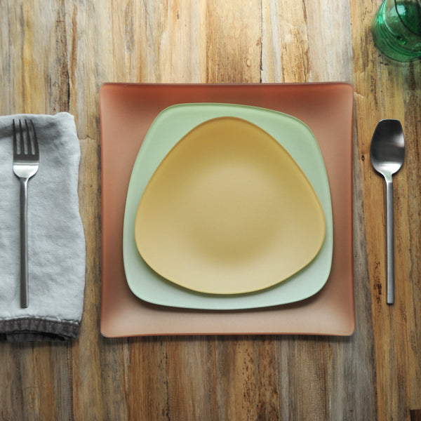 Seaglass place setting with gold triangle plate