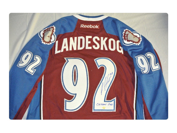 Gabriel Landeskog Signed Burgundy (Home) Jersey with Calder Inscription