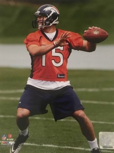 Tim Tebow Unsigned 8x10 photo - Latitude Sports Marketing