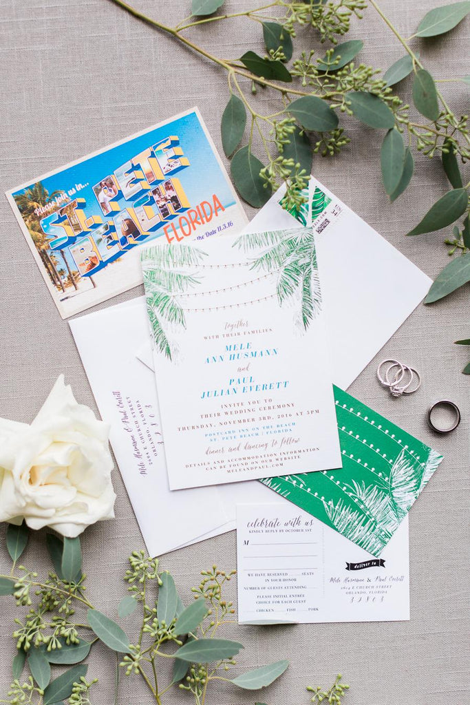 tropical destination wedding invitation with palm leaf