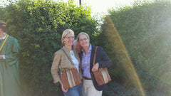 Twins with matching brown leather with hair on hide bucket bags