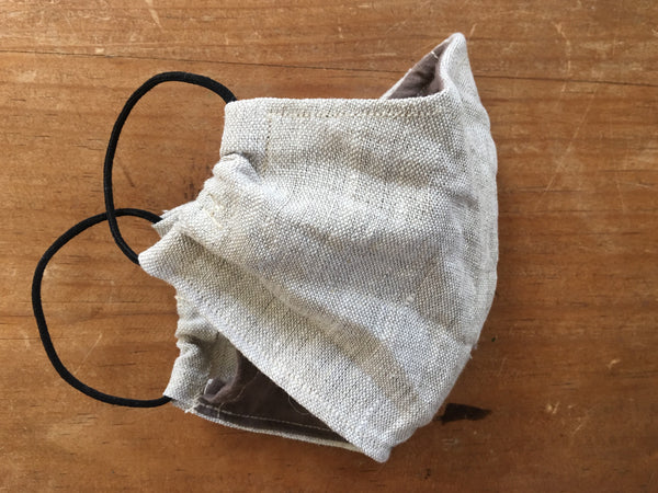 linen face mask in sand