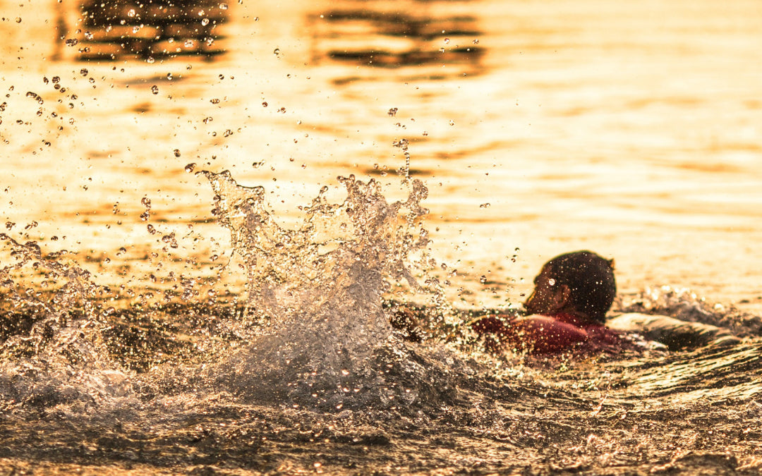Open water swimming at sunrise in hyde park