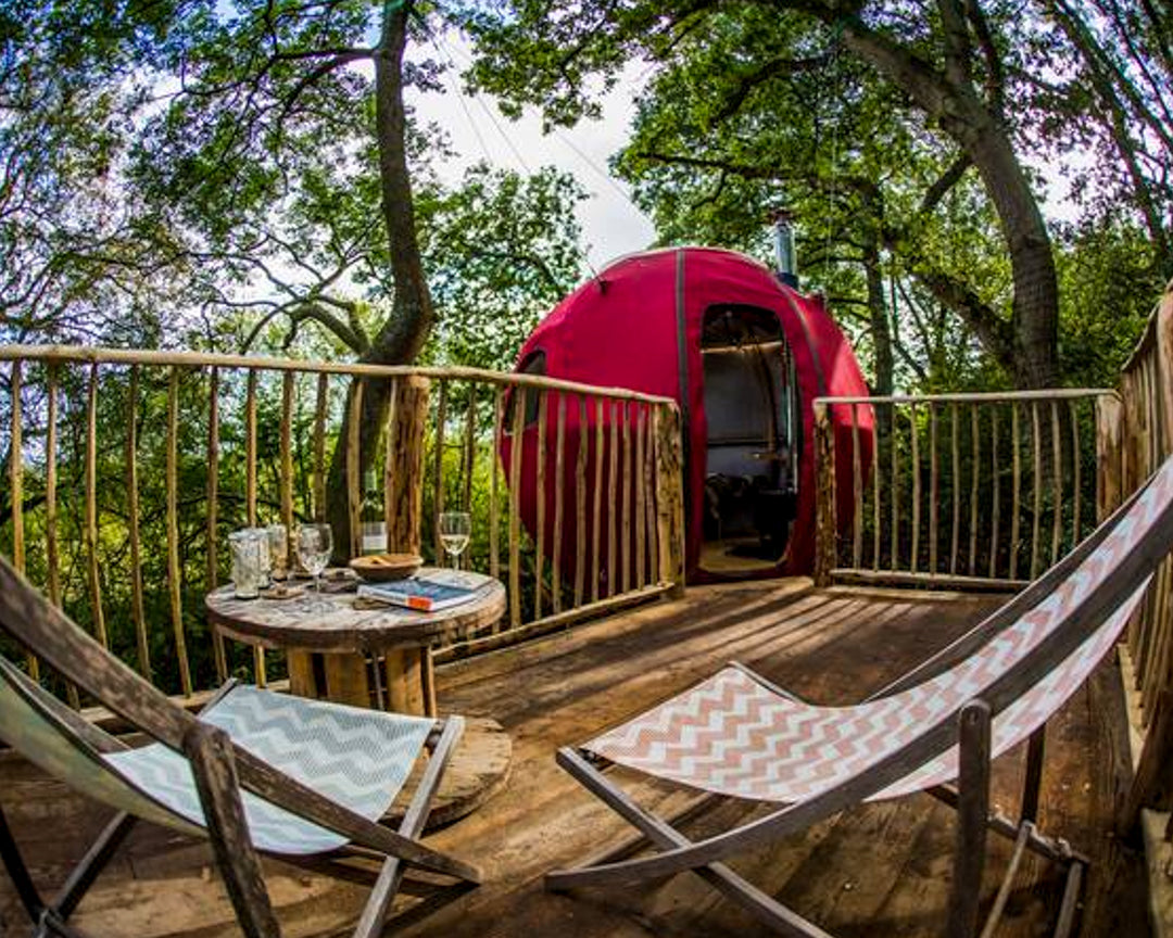 Take climbing into the trees one step further, by staying in a red berry treehouse suspended above ancient bluebell woodland below