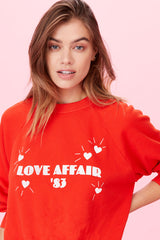 LNA Love Affair Graphic Pullover Sweatshirt in Red