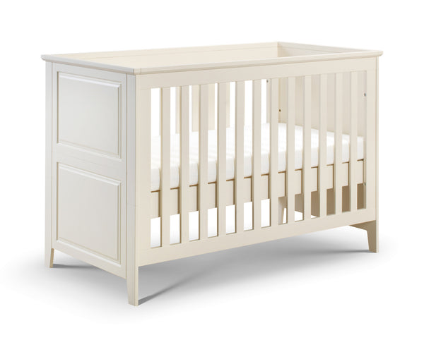 Stone white cotbed that converts to a toddler bed.