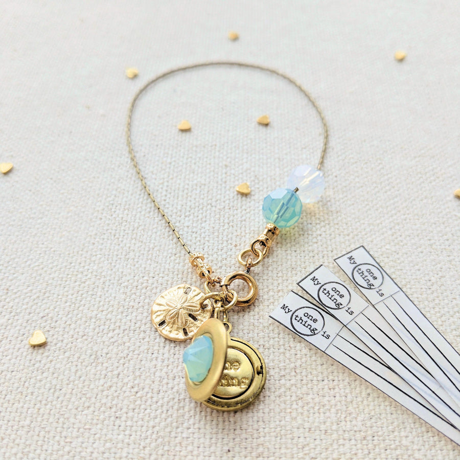 """A SAND DOLLAR FOR YOUR THOUGHTS"" LOCKET BRACELET"