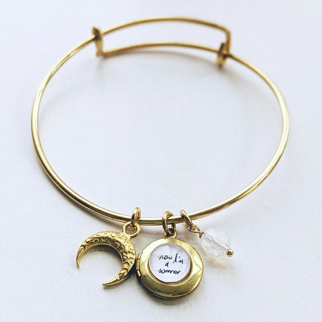 """NOW, I'M A WARRIOR"" MOON & LOCKET CHARM BANGLE - ALL PROFITS DONATED TO PACIFIC POSTPARTUM SOCIETY - One Thing Lockets 