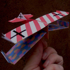 Udet origami airplane with 1916 factoids