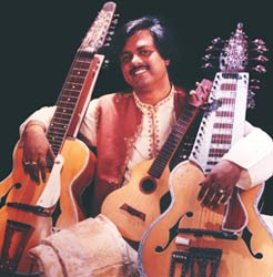 Slide guitarist Debashish Bhattacharya brings Indian classical music to the stage-including a lap-slide chaturangui, a 14-stringed gandharvi, and a four-string slide ukelele