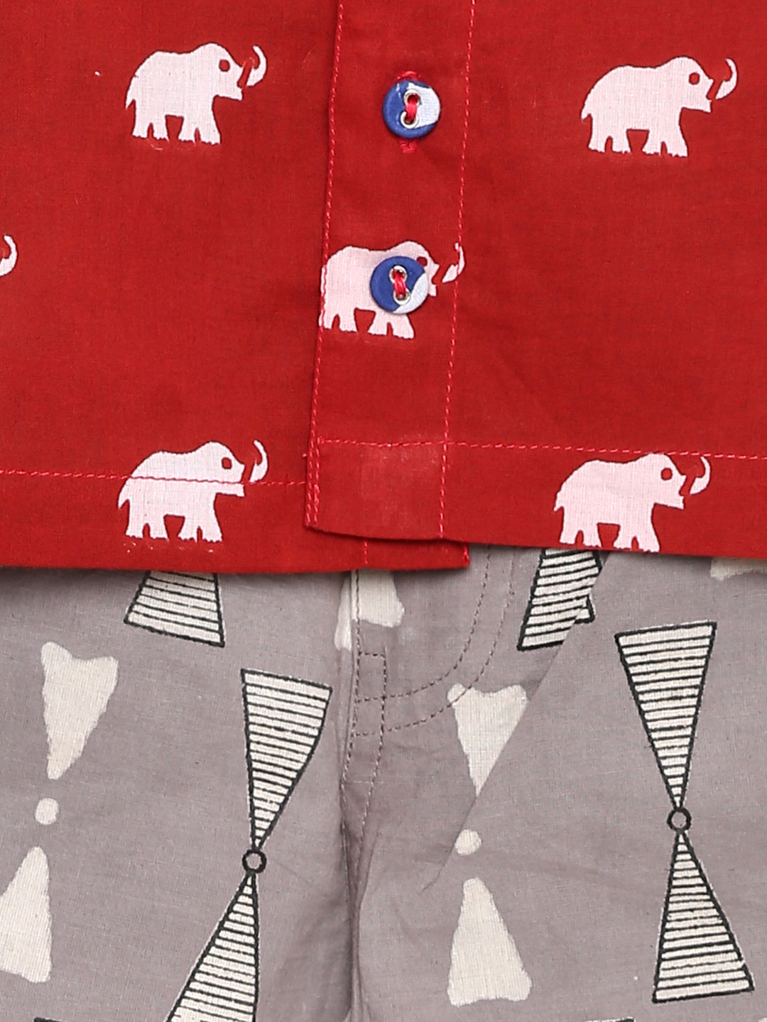 Red elephant print shirt with grey shorts