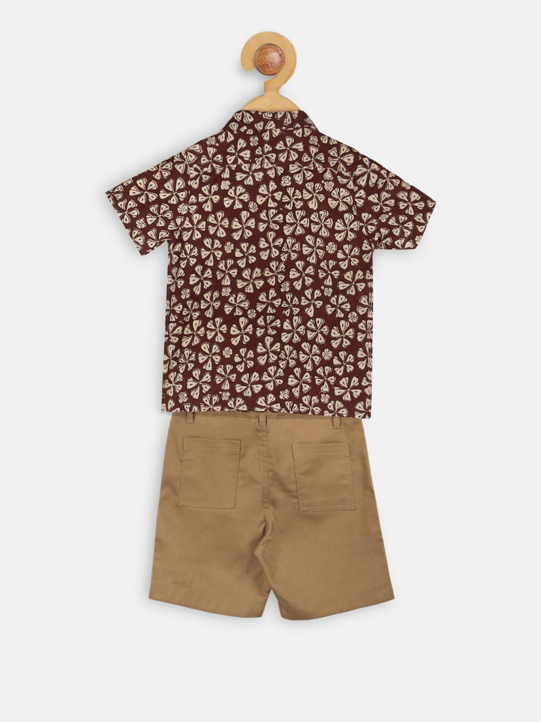 Maroon print shirt with khaki shorts