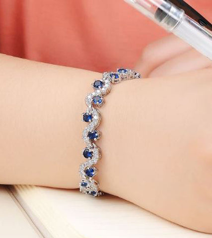 Karatcart Platinum Plated Blue Crystal Bracelet For Women
