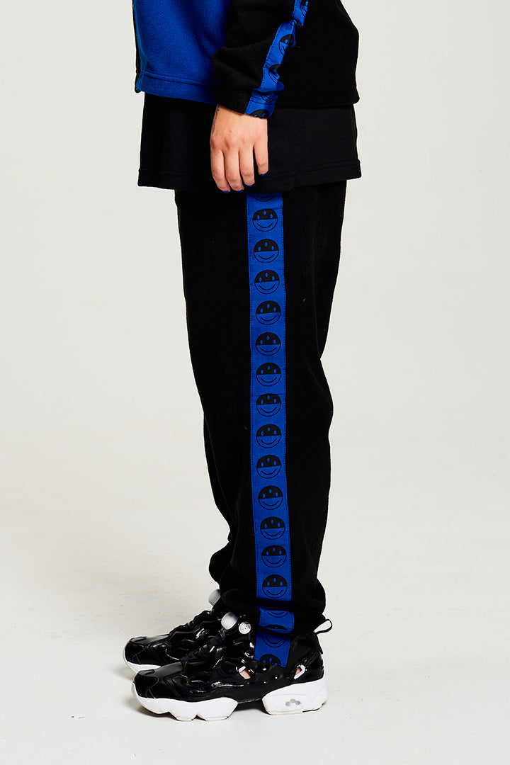 BIBI CHEMNITZ x KROM KENDAMA Polar Fleece Sweatpants with smiley face tape