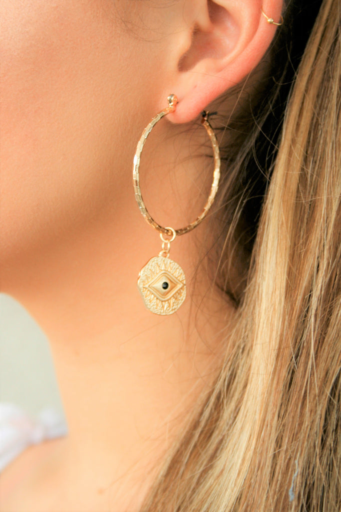 Evil eye gold tone hoops