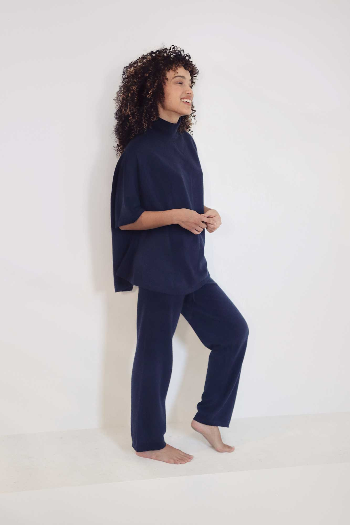 Model posing with navy loungewear