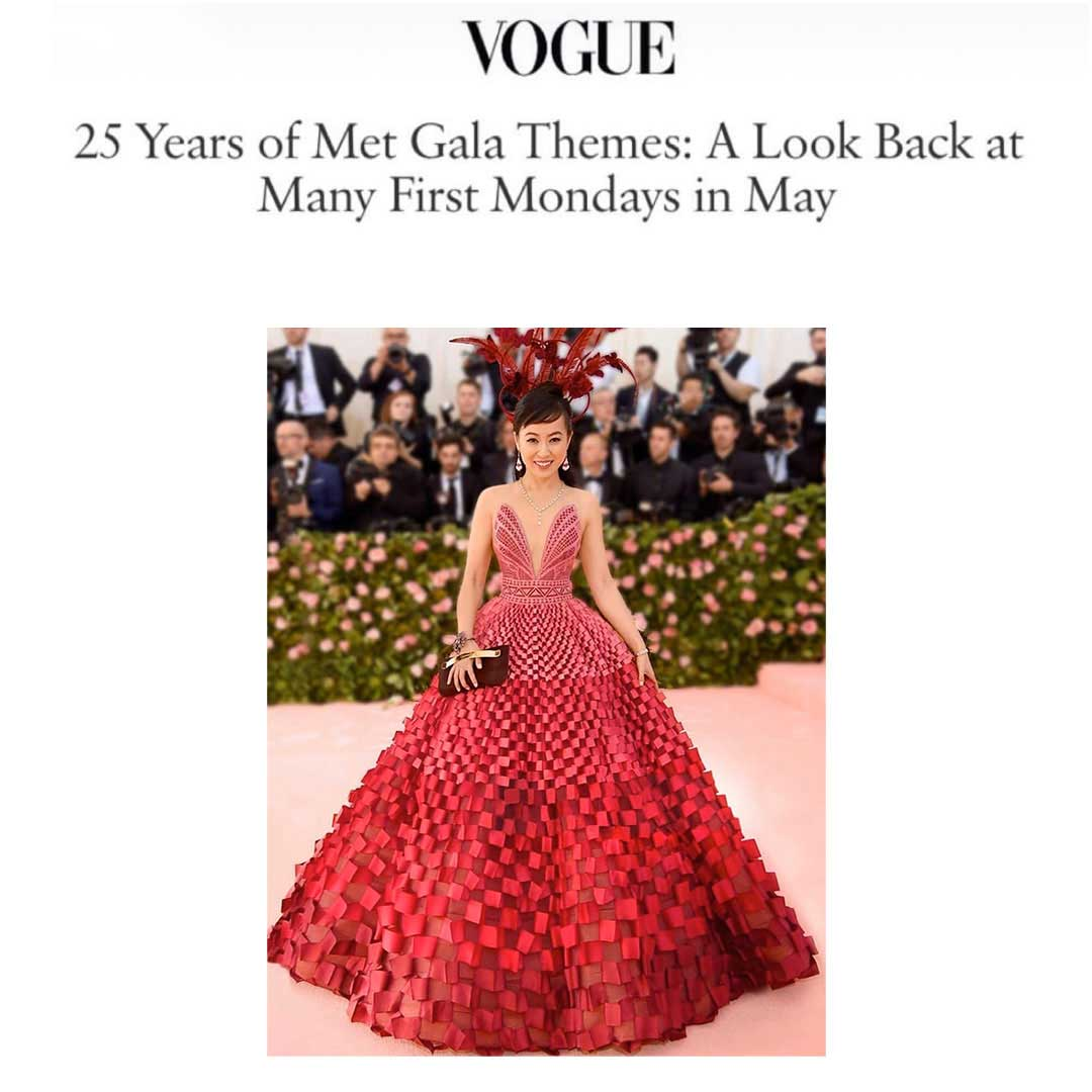 Coral posing with red dress with Vogue headline