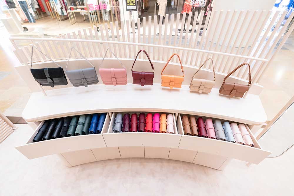 Handbags in Multiple Colors on Shelf