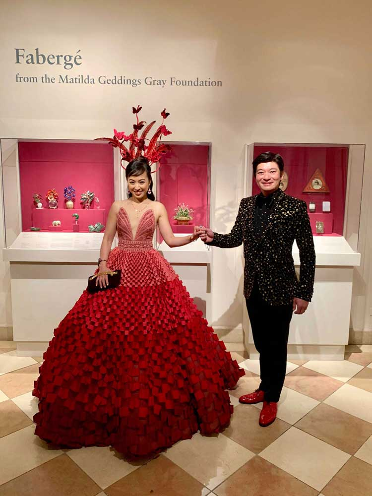 Coral and husband posing in front of Faberge exhibit