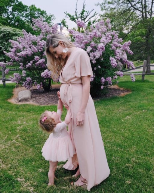 Margot posing outdoors with her daughter