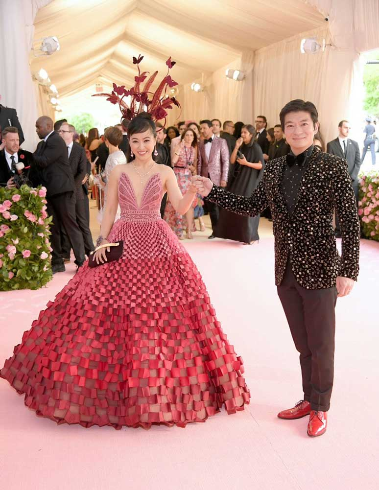 Coral and husband posing on pink carpet