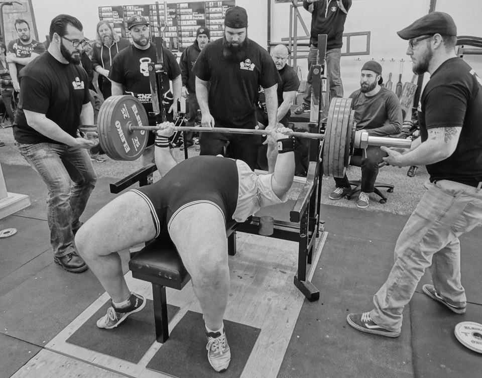 Register for a powerlifting meet and watch your training explode