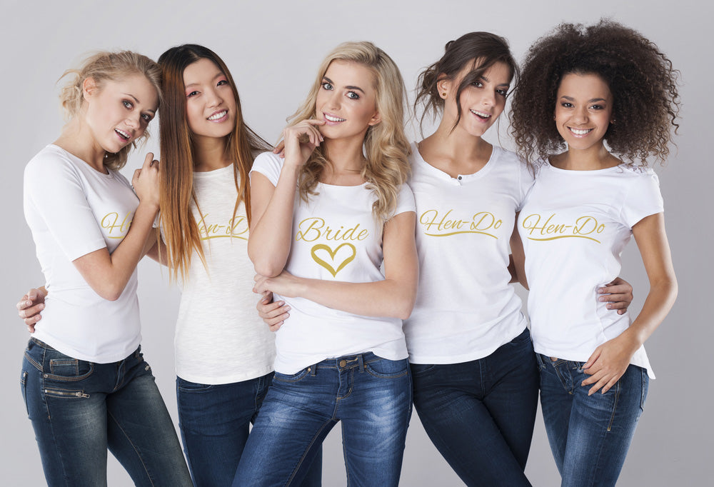 Five women together wearing hen party custom t-shirts.