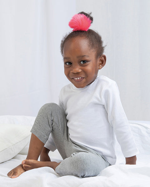 Little girl modelling plain white long-sleeve baby t-shirt that you can personalise