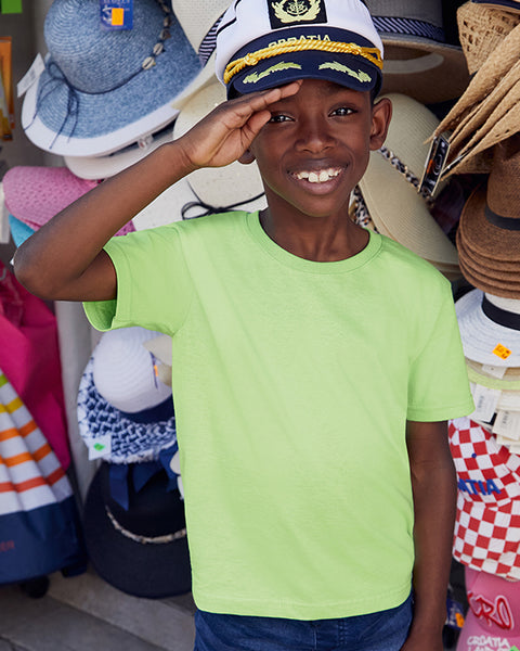 Young Boy wearing sailor hat modelling a plain lime green kids t-shirt that you can personalise