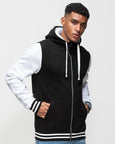 Black man with short black hair modelling a black and white varsity hoodie, on which you can add your on design