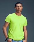 Man with short black hair modelling a plain lime green t-shirt for custom print