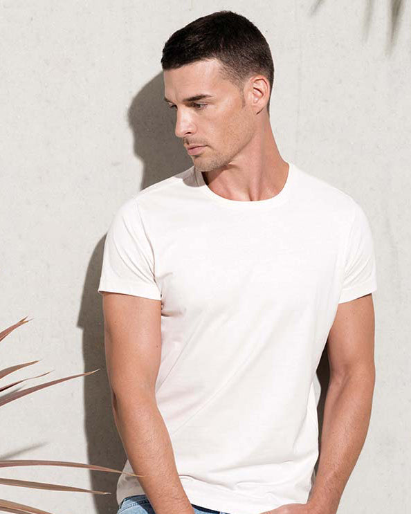 Man with short black hair modelling an organic white t-shirt that you can personalise