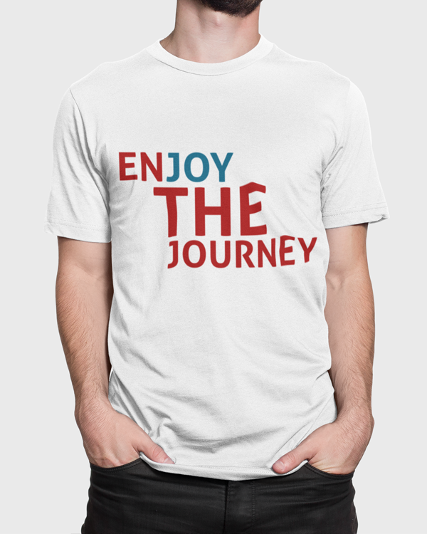 Man wearing a white t-shirt with a slogan saying Enjoy the Journey