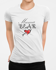 Woman wearing a white t-shirt with a Mama Bear and Heart Logo