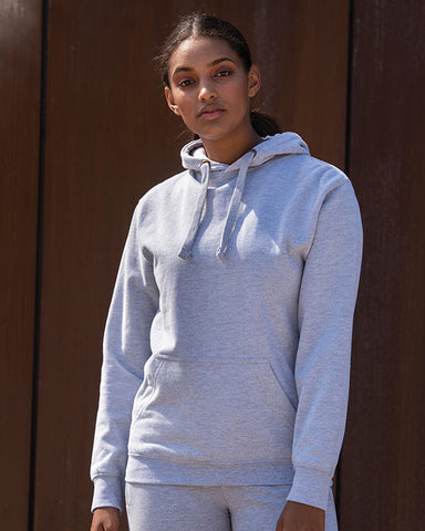 Young black woman with black hair modelling a plain grey hoodie on which you can add your on design