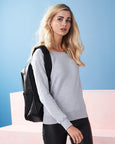 Woman with blonde hair modelling a grey sweatshirt that can be personalised with custom design