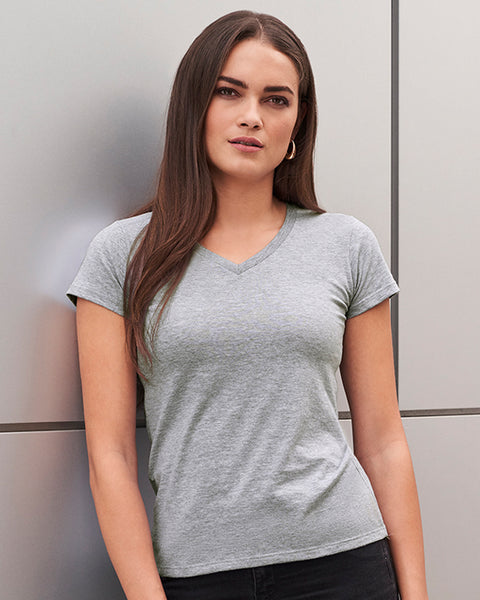 Woman with dark brown hair modelling a grey v-neck t-shirt that can be personalised with custom design
