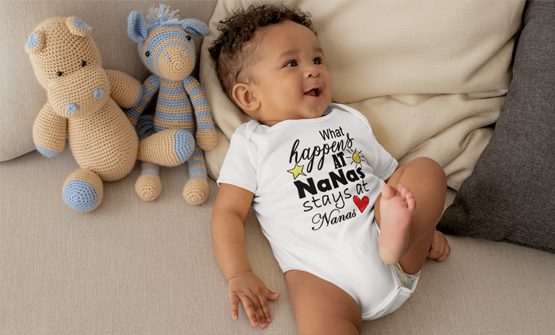 Baby with a personalised and custom baby grow vest