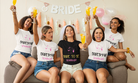 Hen Party wearing custom hen party t-shirts sitting on a chair celebrating