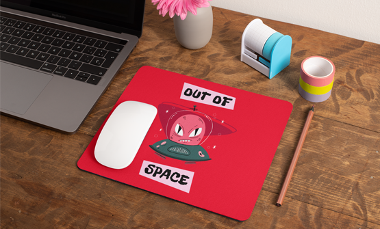 Personalised and custom mouse pad sat on a table next to a laptop
