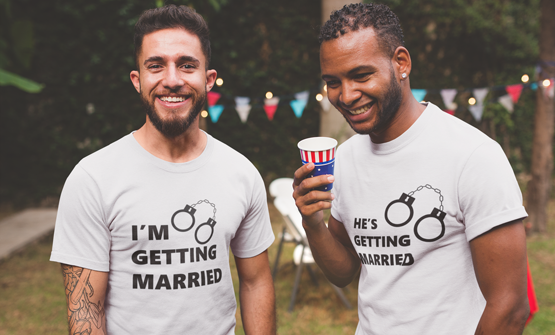 Two men smiling wearing their white custom design t-shirts with a personalised t-shirt design for Stag party